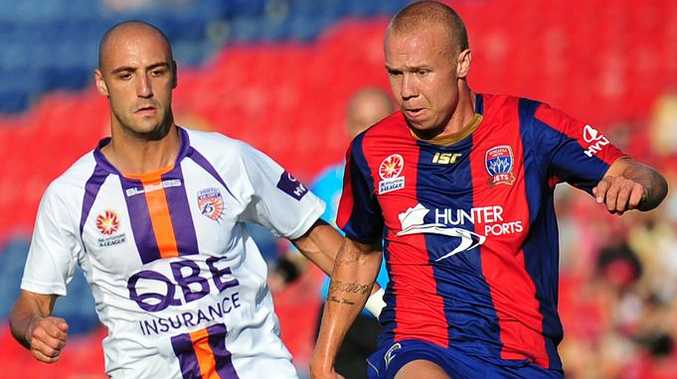 Billy Mehmet and Taylor Regan fight for the ball in an A-League Soccer clash between the Newcastle Jets and Perth Glory.