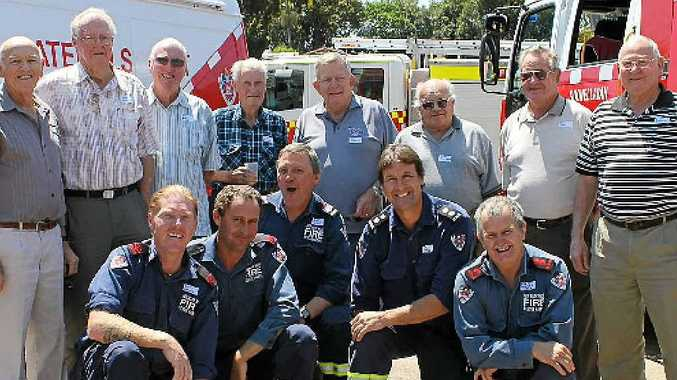 TO THE RESCUE: Some of the original members of Goonelabah Fire Brigade celebrate 40 years of the local fire service alongside current members.