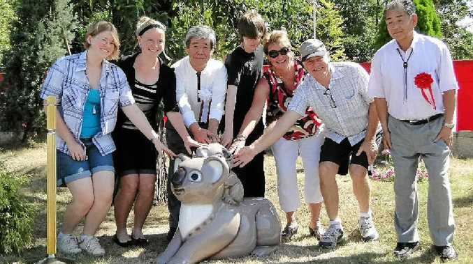SISTER CITY: Students and visitors from Lismore with Yamato Takada representatives admire one of the sculptures in the new Lismore Gardens unveiled recently in the Japanese city.