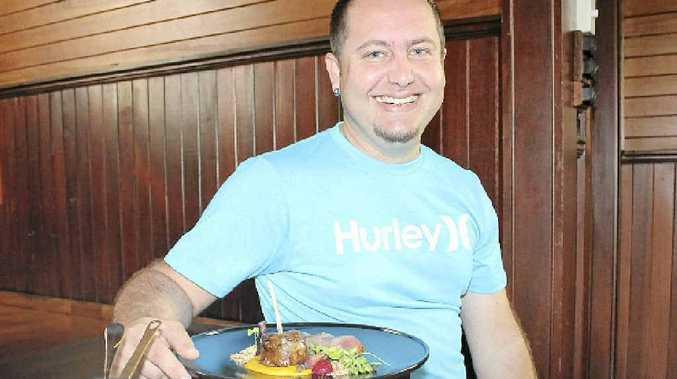 Owner Peter Fleming celebrates the Golden Fork awarded to Church at Alphadale restaurant in last week's Sample Food Festival.