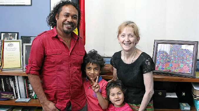 TIMOR CONNECTION: Ego Lemos and his children, Maucello (peace sign) and Avida, meet with Janelle Saffin to recall shared East Timor time.