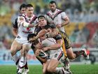 Elijah Taylor faces some heavy defence in a game against the Brisbane Broncos.