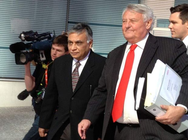 Former Bundaberg surgeon Jayant Patel (left) leaves the court with barrister Kenneth Fleming.
