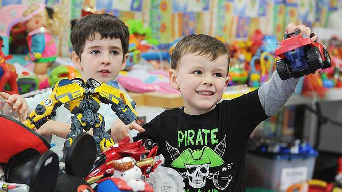 Ryan Ellis and Kai Francis check out the toys at Lifeline's Mega Book and Toy Sale in Maryborough.