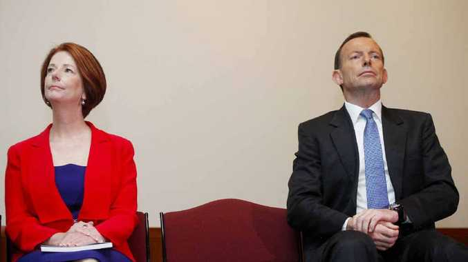 Prime Minister Julia Gillard and Opposition Leader Tony Abbott at a function show their working relationship is at times less than close.