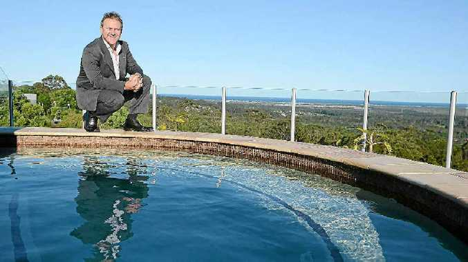 TOP SPOT: Agent Simon Thomas shows off the vast views of the Coast from the Buderim penthouse and its rooftop pool.