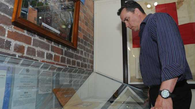 Cross of Valour recipient Tim Britten looks at the newly created display at the Maryborough War Museum.