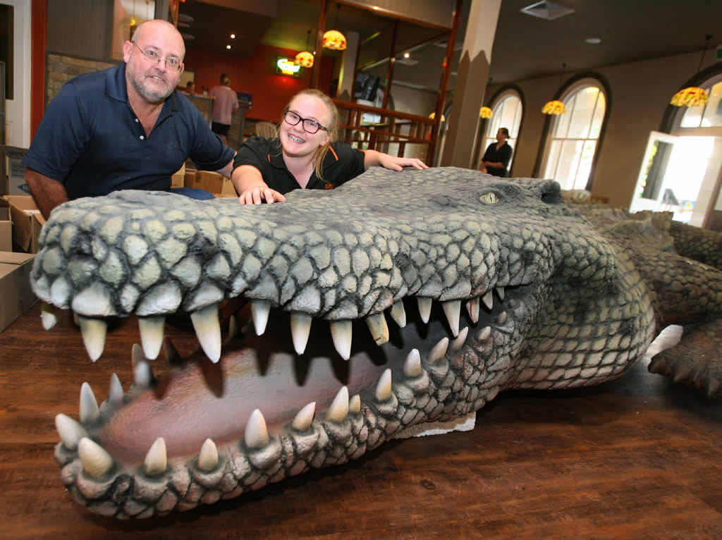 SNAP IT UP:  Tony and Melita Henderson pat the massive croc which will hang upside down from the ceiling of Rockhampton's newest restaurant, Outback Jacks.