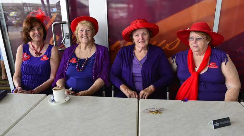 (L-R) Lady Dragonfly Narelle, Lady Pimrose Rosemary, Grand Duchess of Summerset Pam and Grand Duchess Daphne from the Red Hat Tropicanas enjoying lunch at The Coffee Club.