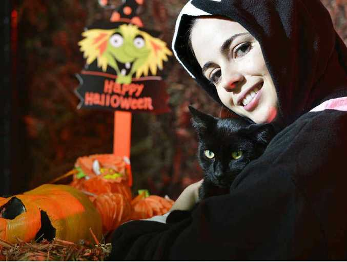 Carmen Glanville from the RSPCA at Wacol cuddles Baghara a black domestic short haired cat. October is Black Magic month at the RSPCA where they are highlighting all black pets and will be offering two-for-one adoptions.