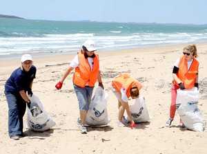 Dead sea turtle among rubbish on beach