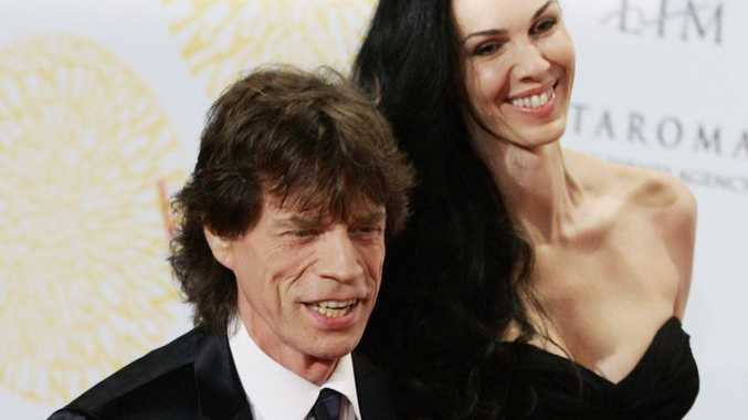 Mick Jagger flanked by his girlfriend L'Wren Scott arrive at a grand-gala ball on the occasion of Italian fashion designer Valentino 45th anniversary celebrations.