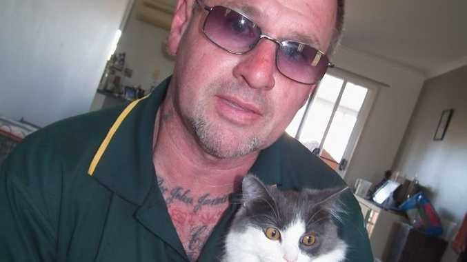 Animal chiropractor Doc Jamieson with Bugsy the cat that can walk again after being paralysed.