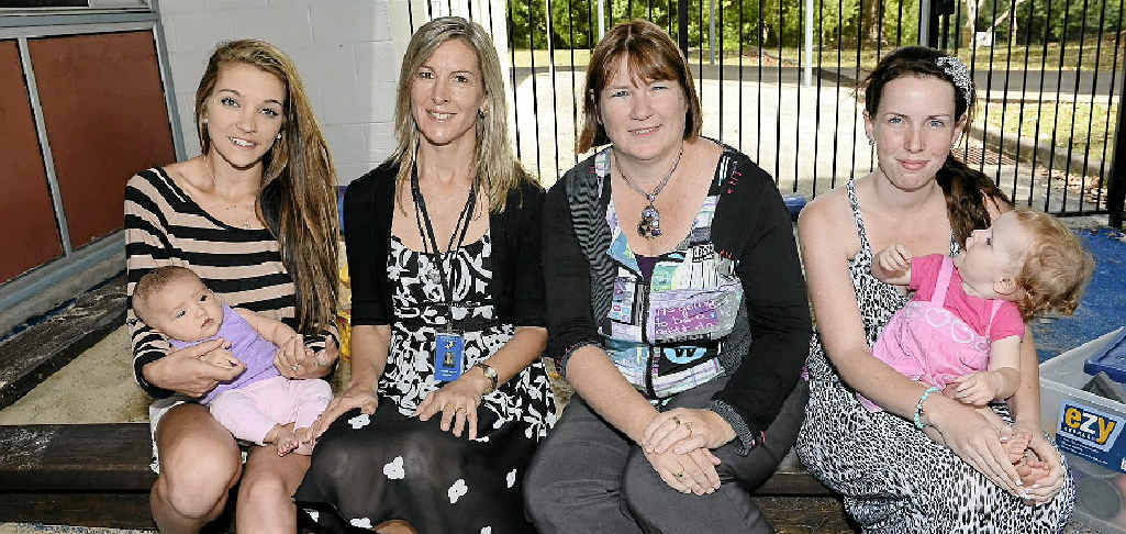 MAKING A DIFFERENCE: Student Tallulah Mackay and daughter Destiny with program co-ordinators Janelle Logan and Jacqui Dean with student Amy and daughter Bella.