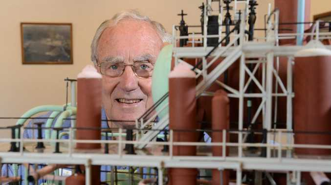 Warren Martens with a model of the Stanwell/ Swanbank B Plant where he has worked since 1966. The Swanbank Power Station are showcasing models and relics from the station.
