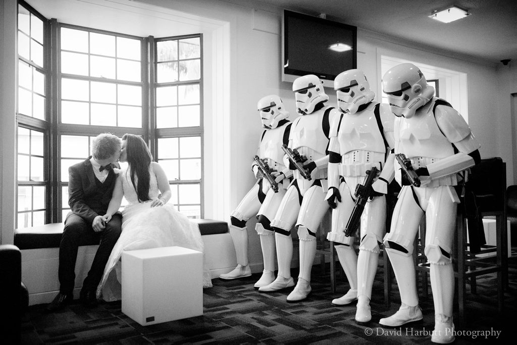 The happy couple share a special moment as their stormtrooper bridal party look on. Photo: David Harbutt Photography.