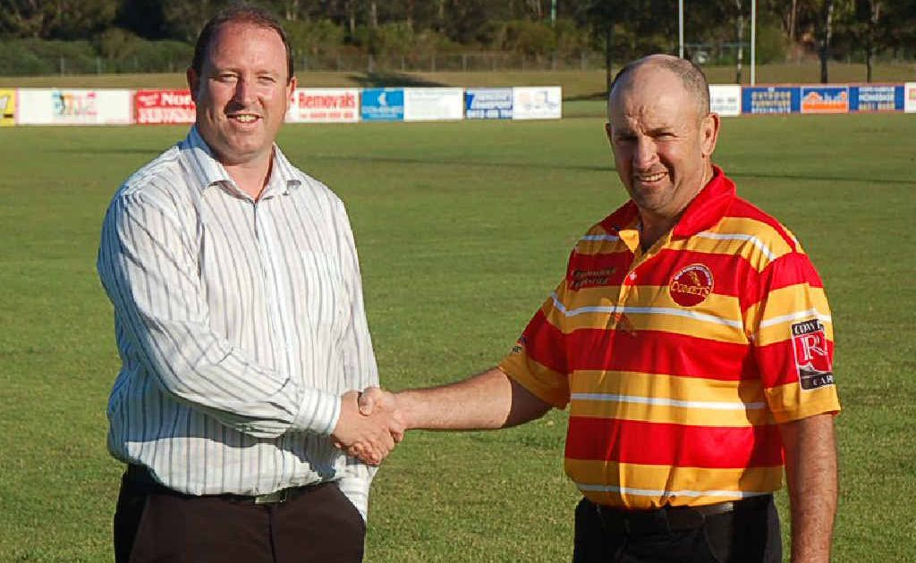 Michael Close of the Gold Coast Titans and incoming Coffs Comets coach Col Speed. Photo: Nick Houghton