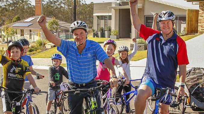 SAFE RIDERS: Youngsters join Mayor Paul Pisasale and Michael Stone in the community ride.
