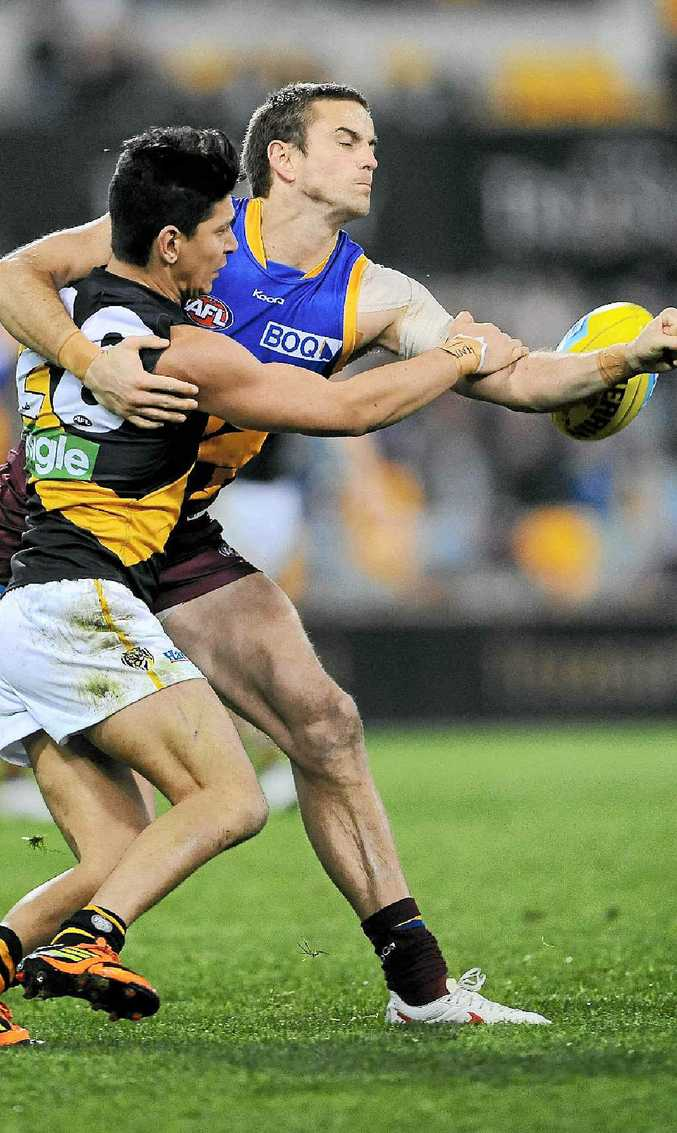 HARD MAN TO BEAT: Brisbane's Josh Drummond spoils a marking attempt by Richmond's Robin Nahas on August 4 at the Gabba.