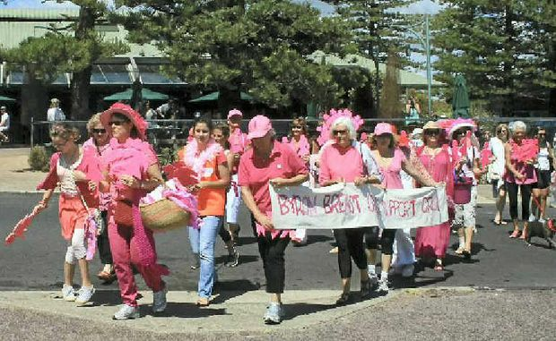 PAINTING THE TOWN PINK: The silent marchers reach Apex Park at the weekend, to raise awareness about breast cancer.