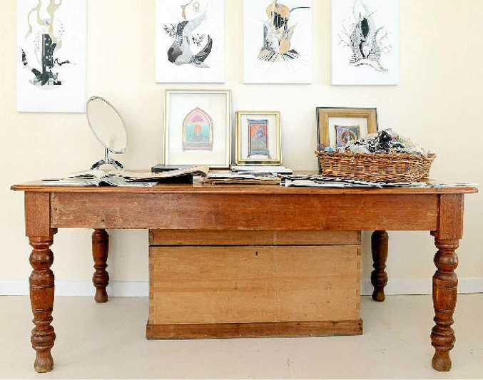 A beautiful old Baltic pine table in Gowan's studio. A collection of Gowan's work can be seen on the table and white walls.