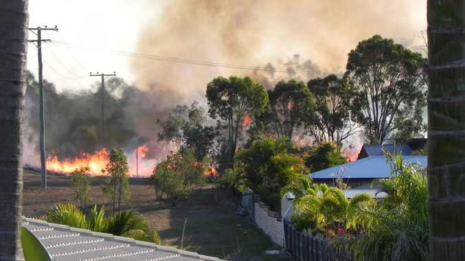 A fire at Tannum Sands yesterday afternoon came close to houses.