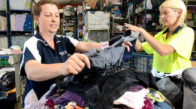 BARGAINS GALORE: Colleen Reside and Trish Roach sort through the clothes at Lifeline.