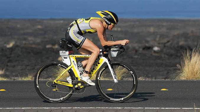 TORTURE TEST: Fearless Ipswich competitor Kym Jaenke powers on at the hot and windy Hawaii Ironman championship despite a nasty fall.