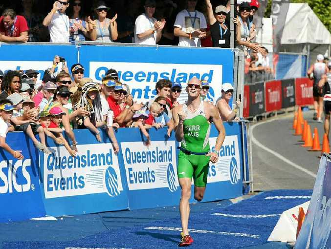 Peter Kerr heads for the finish line and third position in the 2010 Noosa Triathlon.