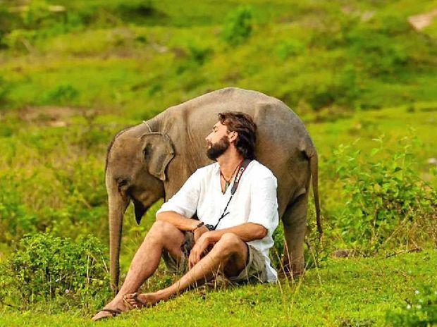 Murray Munro with Bona the orphaned elephant in Sumatra.