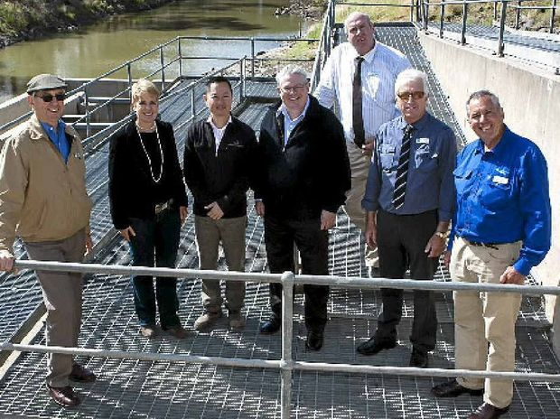 PARTNERS WITH PURPOSE: Condamine Alliance chairman John Herbert, Arrow Energy social investment team leader Peta Tucker, Ostwald Bros engineer John Huynh, CEO Phil McCullough, Western Downs Regional Council deputy mayor George Moore, councillor Ray Jamieson and principal project officer Kevin Graham.