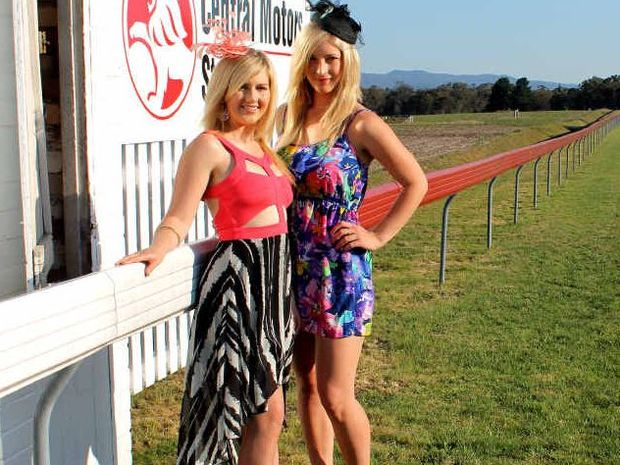 Kyrie Sweeney and Ashleigh Taylor take a test run of their races Fashion of the Fields outfits in the lead up to the Central Motors Holden Stanthorpe Cup Day on Saturday.