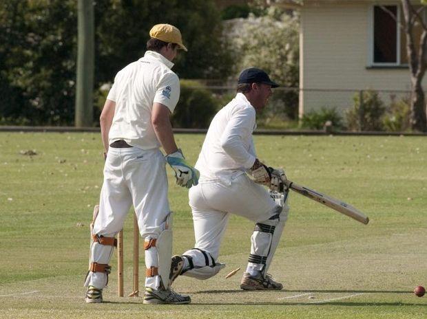 GOTCHA: Metropolitan-Easts batsman Mark Dealing is bowled at Harristown Park.