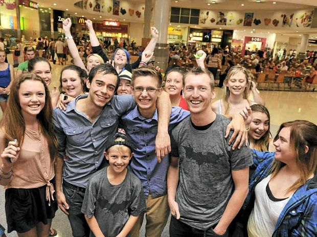 IN THE FLESH: Fans gather at Lismore Shopping Square to meet Big Brother housemate Bradley Darke of Coraki.