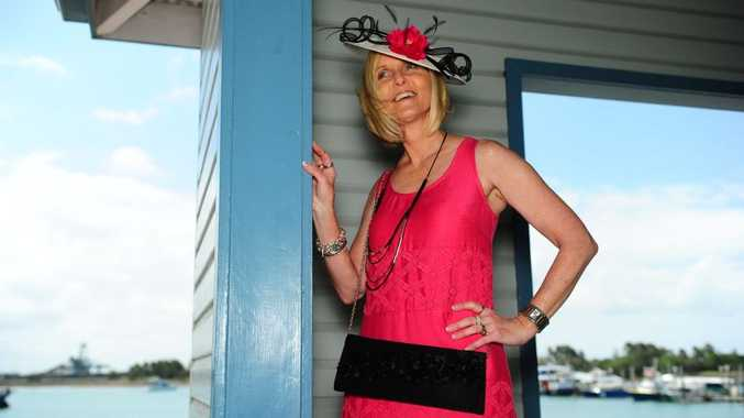 Fantasy Rags store assistant Rhonda Huston models race day and cocktail party fashion.