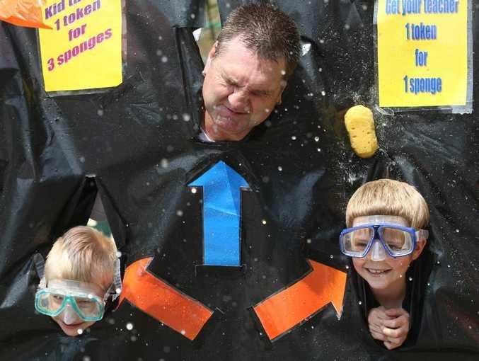 Damon Cox, teacher Shaun Tavernor and Jarod Baxter get wet and wild at the sponge toss at Centaur school's Carnivale.