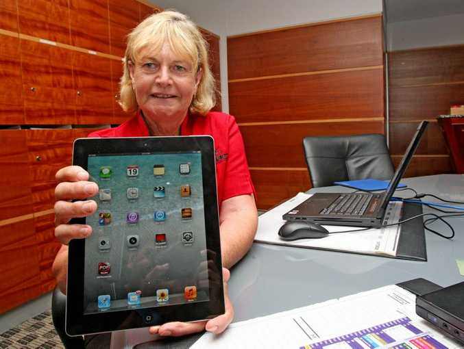 Joyce Hawker is learning some computer skills so she can talk to her relatives in England.
