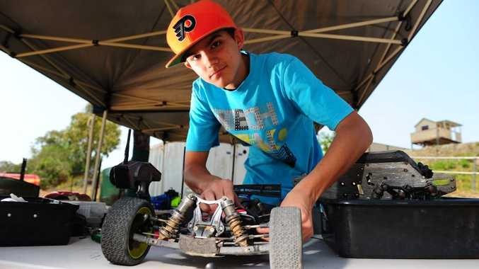 Jay Lanzon, 14, works on his vehicle at the Gladstone Radio Controlled Car Club meet at Glenlyon Rd.