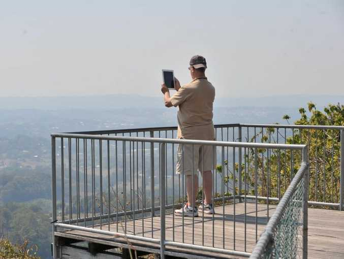 A hazy view over Nambour from the lookout at Dulong due to bush fires burning in the region. Photo: Brett Wortman / Sunshine Coast Daily