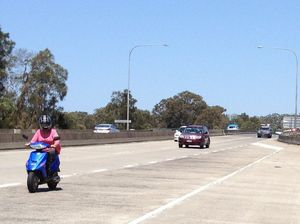 Cheeky moped rider busted poking along the highway