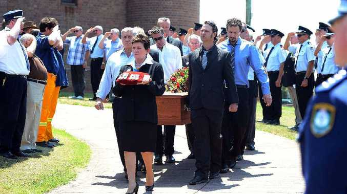 SALUTES FOR A SERVICEMAN: Military background people in the funeral pay their respects to Kevin Muldoon at St Carthages Cathedral,