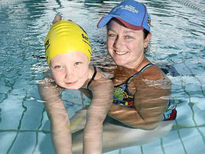 Swimming instructor Sara Kent with Ella Bawden, 6.
