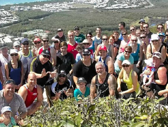 Brad and Patricia with family and friends at the top of Mt Coolum.