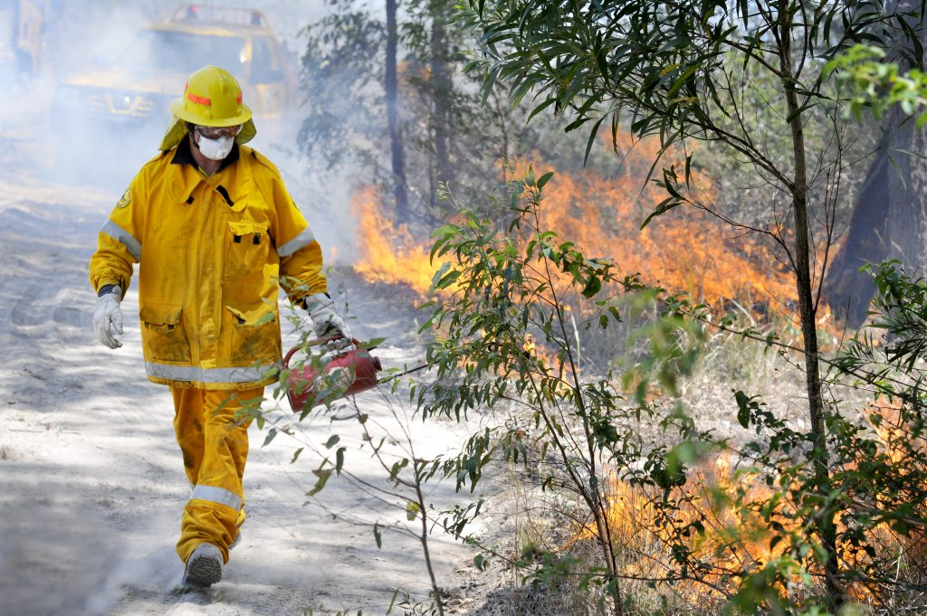 Emu Creek Rural Fire Brigade volunteer Trent Young backburning near Crows Nest.