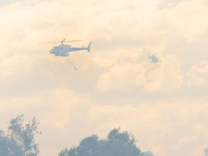 Helicopters join the battle against fire at Beachmere
