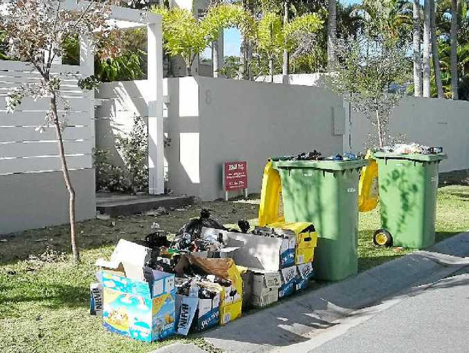 Rubbish lines a street in upmarket Witta Circle at Noosa Sound.