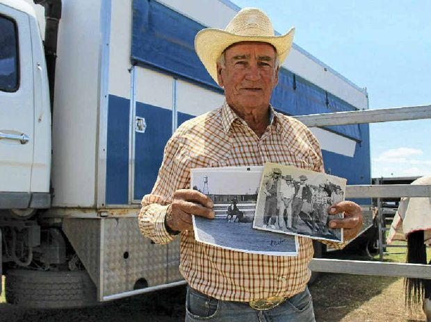Vic Gough holding some photos of him competing at the Warwick Rodeo events in the early days.
