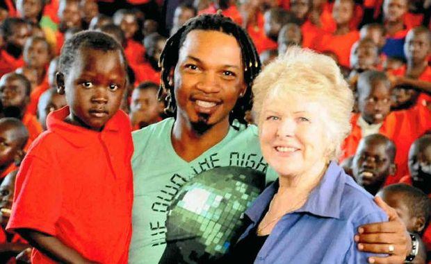 SONGS OF HOPE: George Lubega and Irene Gleeson with kids from the Irene Gleeson Foundation in northern Uganda.