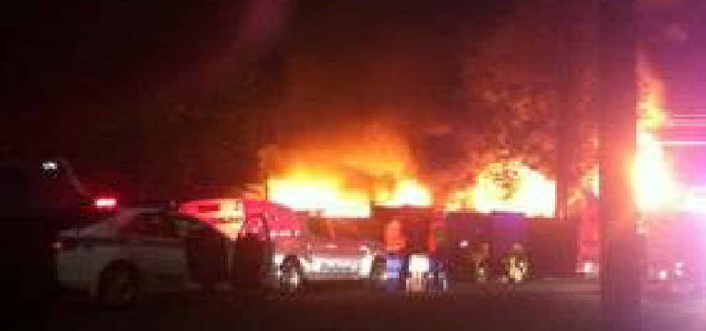 FLAMING INFERNO: A photo supplied by a neighbour showing the fire destroying the house in Newbridge Street, South Lismore.
