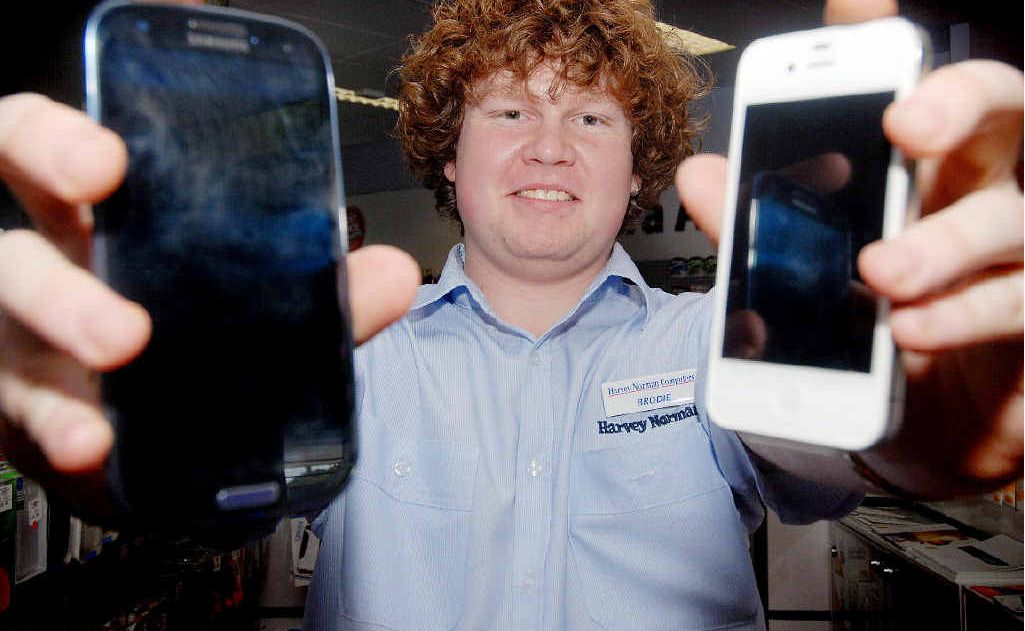 Technology specialist Brodie Ramsay with the Galaxy and an iPhone, two of the stores most popular selling phones.